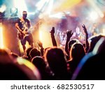 crowd with raised hands at... | Shutterstock . vector #682530517