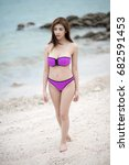 asian woman in purple bikini on ... | Shutterstock . vector #682591453