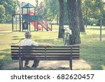 old man sitting on a bench ...   Shutterstock . vector #682620457