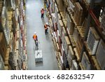 above view of warehouse workers ... | Shutterstock . vector #682632547