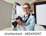 happy photographer in modern... | Shutterstock . vector #682634347
