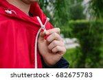 a man zips up a jacket. hands... | Shutterstock . vector #682675783
