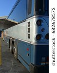 Small photo of BAKERSFIELD, CA - JULY 19, 2017: In the early morning a Greyhound bus is serviced and ready for driver and passengers in a few hours.