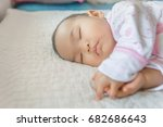 asian cute baby girl sleep on... | Shutterstock . vector #682686643