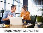 two laughing coworkers... | Shutterstock . vector #682760443