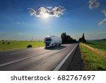 truck transportation at sunset | Shutterstock . vector #682767697