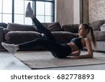 young sporty female doing abs... | Shutterstock . vector #682778893