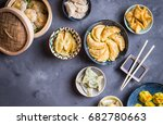 assorted dim sum appetizers on... | Shutterstock . vector #682780663