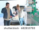 delivery man phoning before... | Shutterstock . vector #682810783
