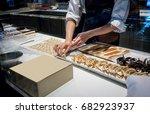 pastry chef hands working on... | Shutterstock . vector #682923937