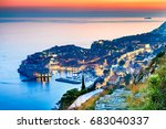Small photo of Dubrovnik, Croatia and twilight picturesque view on the old town of Ragusa on Dalmatian Coast at Adriatic Sea.