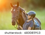 Small photo of Young woman rider with her horse in evening sunset light. Outdoor photography in lifestyle mood