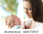 tired desperate mother holding... | Shutterstock . vector #683173927