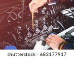 close up hands checking lube... | Shutterstock . vector #683177917