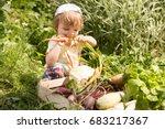 cute little girl eats fresh... | Shutterstock . vector #683217367