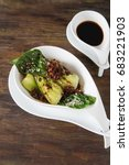 Small photo of Cooked bok choy or chinese cabbage with sesame and soy sauce. Simple background. Healthy food. Lifestyle