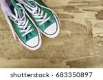 sneakers on an old wooden... | Shutterstock . vector #683350897