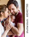 beautiful young parents holding ... | Shutterstock . vector #683407783