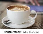 cup of coffee on a wooden table ... | Shutterstock . vector #683410213