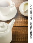 Small photo of white ware for coffee on a wooden table/elements of kitchen white ware for coffee