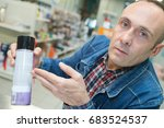 Small photo of Man showing aerosol can