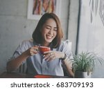 asian woman drinking coffee in... | Shutterstock . vector #683709193