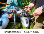 hands of a fisherman with a... | Shutterstock . vector #683745307