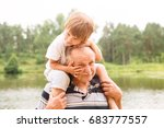 small boy is sitting on his...   Shutterstock . vector #683777557