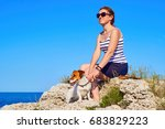 young woman with dog breed jack ... | Shutterstock . vector #683829223
