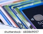 credit cards pile shallow dof | Shutterstock . vector #683869057