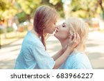 woman giving a kiss looking at... | Shutterstock . vector #683966227