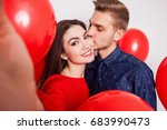 young handsome guy kisses his...   Shutterstock . vector #683990473