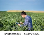 young handsome agriculture...   Shutterstock . vector #683994223