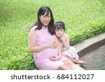 vietnamese pregnant woman with... | Shutterstock . vector #684112027