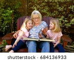 twin sisters take time out for... | Shutterstock . vector #684136933