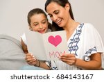 mother receiving a greeting... | Shutterstock . vector #684143167