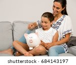mother and daughter putting... | Shutterstock . vector #684143197