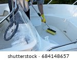cleaning boat with brush by... | Shutterstock . vector #684148657