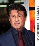 Постер, плакат: Sylvester Stallone arrives to
