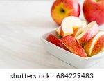 fresh apple sliced in white bowl | Shutterstock . vector #684229483