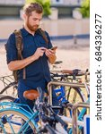 a man with smartphone near... | Shutterstock . vector #684336277
