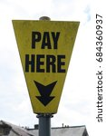 Small photo of Pay here sign information UK