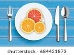 flatware with citrus fruits on...   Shutterstock .eps vector #684421873