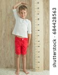 measuring the growth of a child | Shutterstock . vector #684428563