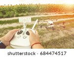 remote control in the hands of... | Shutterstock . vector #684474517