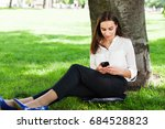 girl works with her phone... | Shutterstock . vector #684528823