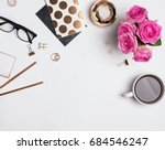 woman's workplace with gold... | Shutterstock . vector #684546247