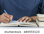 men study while holding a pen | Shutterstock . vector #684553123