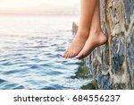 wet bare girl's feet dangling... | Shutterstock . vector #684556237
