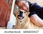 asian woman selfie with dog | Shutterstock . vector #684603427